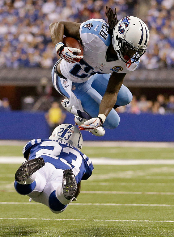. Tennessee Titans\' Chris Johnson (28) is tackled by Indianapolis Colts\' Vontae Davis (23) during the second half of an NFL football game, Sunday, Dec. 9, 2012, in Indianapolis. (AP Photo/Jeff Roberson)