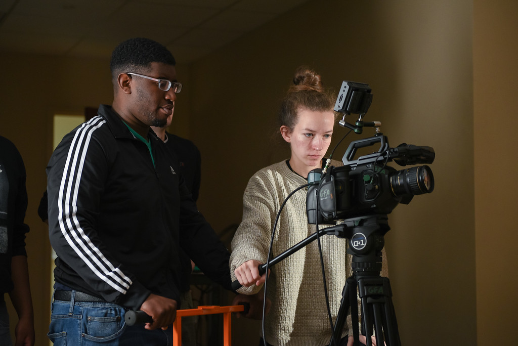 Students use film equipment.