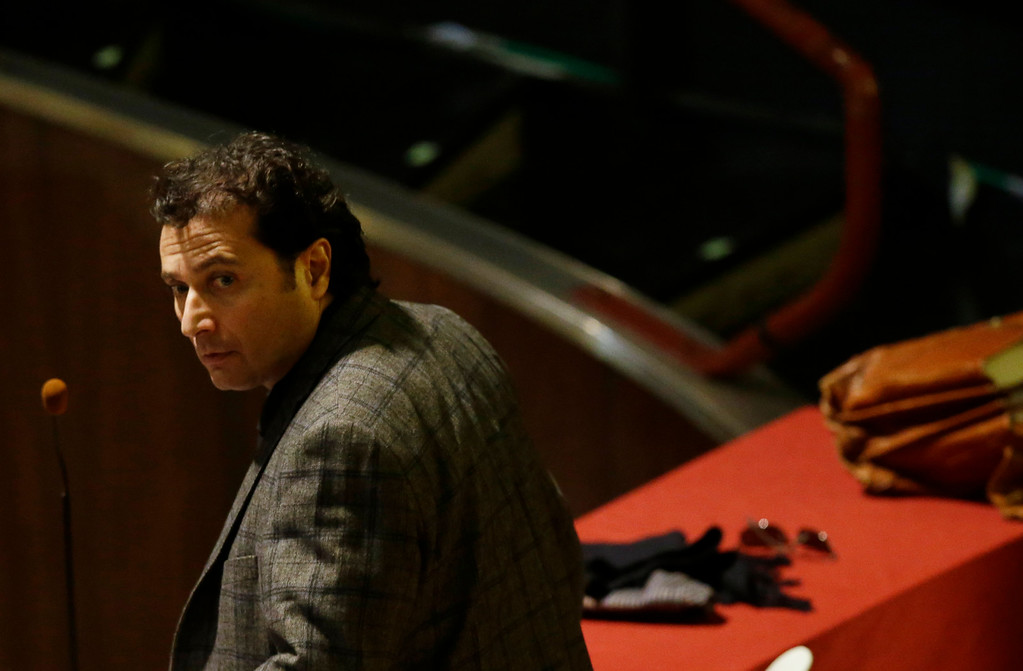 . Francesco Schettino attends his trial in Grosseto, Italy, Wednesday, Feb. 11, 2015. The captain of the capsized Costa Concordia luxury liner has been convicted of multiple charges of manslaughter and sentenced to 16 years in jail. Francesco Schettino wasn\'t present when Judge Giovanni Puliatti read out the verdict Wednesday night in a Grosseto theater. The verdict and sentencing brought a close to a trial that has been running since July 2013. (AP Photo/Gregorio Borgia)