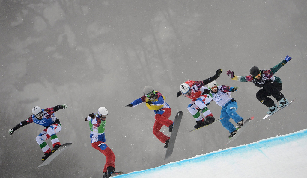 . Luca Matteotti (L) of Italy and fellow competitors in action in the second semi final of the Menës Snowboard Cross at Rosa Khutor Extreme Park at the Sochi 2014 Olympic Games, Krasnaya Polyana, Russia, 18 February 2014.  EPA/VASSIL DONEV