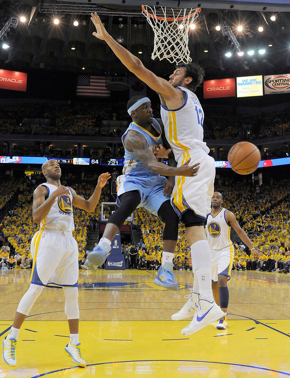 . OKLAND, CA. - APRIL 28: Ty Lawson (3) of the Denver Nuggets passes around Andrew Bogut (12) of the Golden State Warriors in Game 4 of the first round NBA Playoffs April 28, 2013 at Oracle Arena. (Photo By John Leyba/The Denver Post)