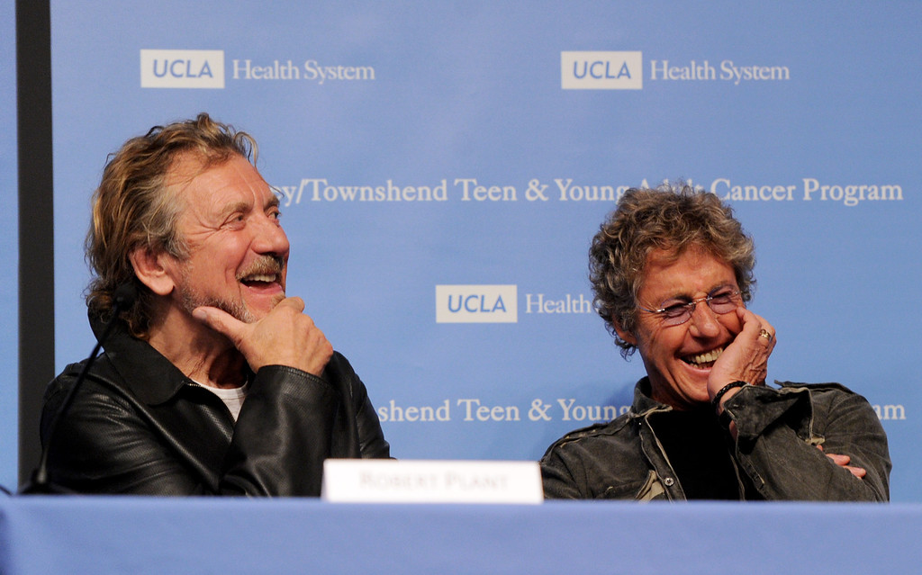 . Singers Robert Plant (L) and Roger Daltrey appear at a press conference to announce the Daltrey/Townsend Teen & Young Adult Cancer Program at UCLA on November 4, 2011 in Los Angeles, California.  (Photo by Kevin Winter/Getty Images)