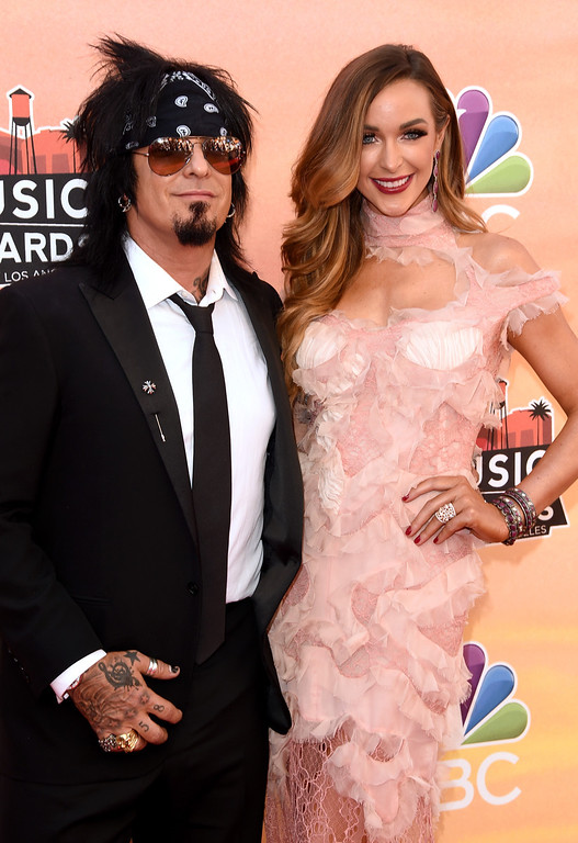 . LOS ANGELES, CA - MAY 01:  Musician Nikki Sixx (L) and Courtney Bingham attend the 2014 iHeartRadio Music Awards held at The Shrine Auditorium on May 1, 2014 in Los Angeles, California. iHeartRadio Music Awards are being broadcast live on NBC.  (Photo by Jason Merritt/Getty Images for Clear Channel)