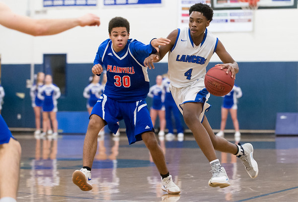 01/07/19 Wesley Bunnell | Staff Bristol Eastern boys basketball in a home game vs Plainvillle on Monday night. Javan Paradis (30) and Jahcyrus Lawrence-Bynum (4).