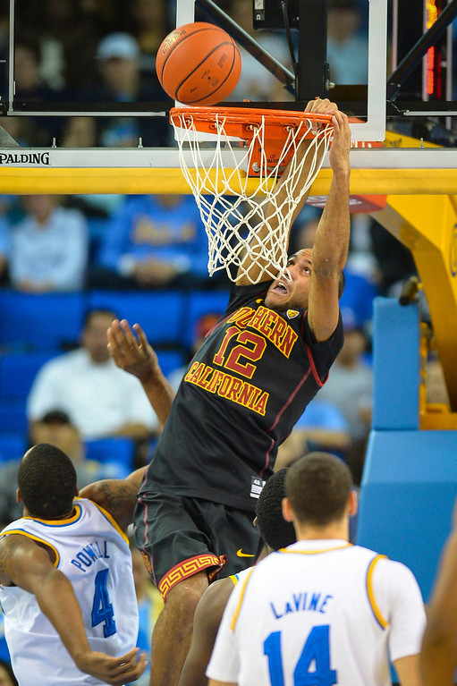 . USC�s Julian Jacobs slams in two points during game action at Pauley Pavilion Sunday, December 5, 2014. UCLA  defeated USC 107-73.  Photo by David Crane/Los Angeles Daily News.