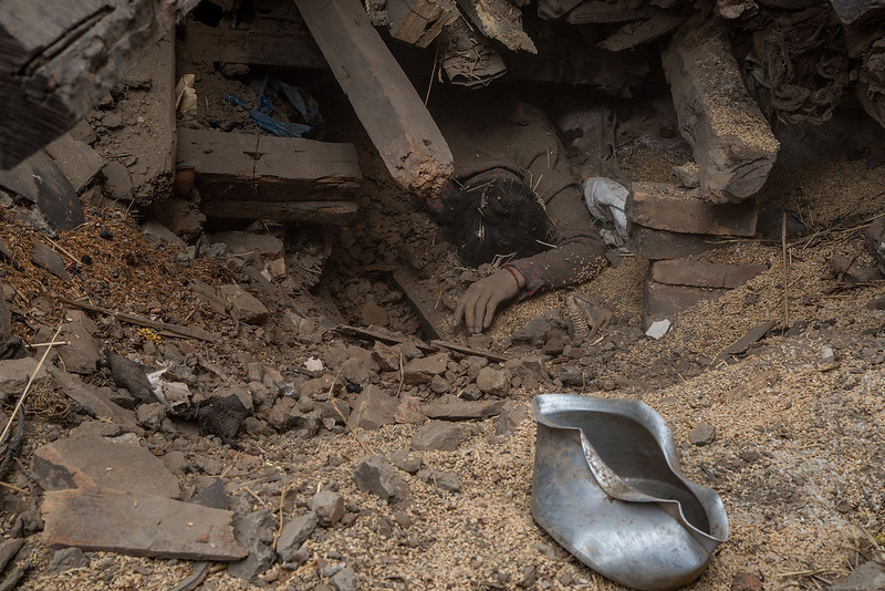 . The body of one of the victims of the earthquake that hit Nepal yesterday lays underneath debris from one of the collapsed buildings on April 26, 2015 in Bhaktapur, Nepal. A major 7.8 earthquake hit Kathmandu mid-day on Saturday, and was followed by multiple aftershocks that triggered avalanches on Mt. Everest that buried mountain climbers in their base camps. Many houses, buildings and temples in the capital were destroyed during the earthquake, leaving thousands dead or trapped under the debris as emergency rescue workers attempt to clear debris and find survivors.  (Photo by Omar Havana/Getty Images)