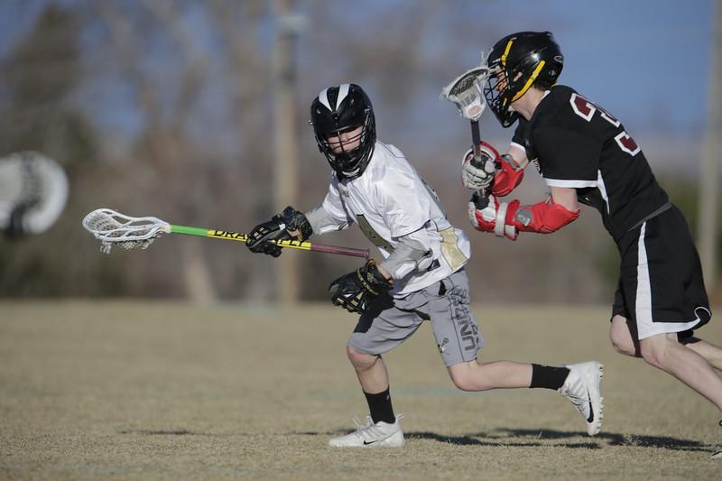 JPM0331-JPM0331-Jonathan first HS lacrosse game March 9th.jpg