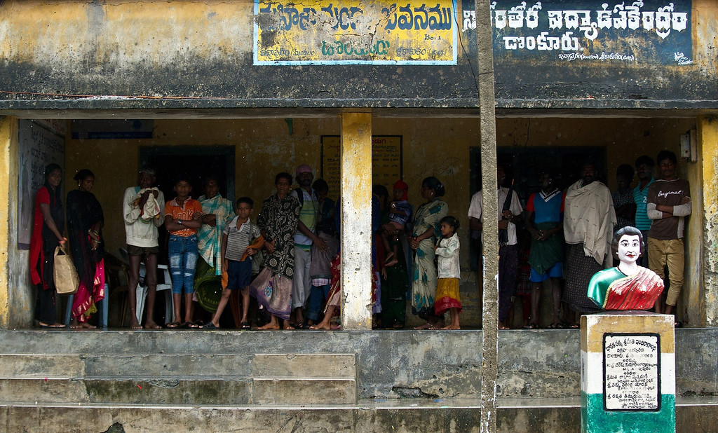 . Indian villagers take shelter under a structure as they flee the coastal Donkuru village in Srikakulam district on October 12, 2013. India evacuated nearly half a million people as massive cyclone Phailin closed in on the impoverished east coast, with winds already uprooting trees and tearing into the flimsy homes. MANAN VATSYAYANA/AFP/Getty Images