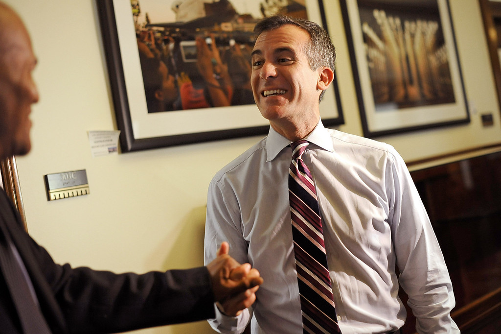 . Mayor Eric Garcetti greets Leonardo Delpit Monday during his first day as Mayor of Los Angeles.   Garcetti held �office hours� at City Hall from 2-5 p.m., during which he met with Angelenos who have emailed requests for help from City Hall July 1, 2013.(Andy Holzman/Los Angeles Daily News)