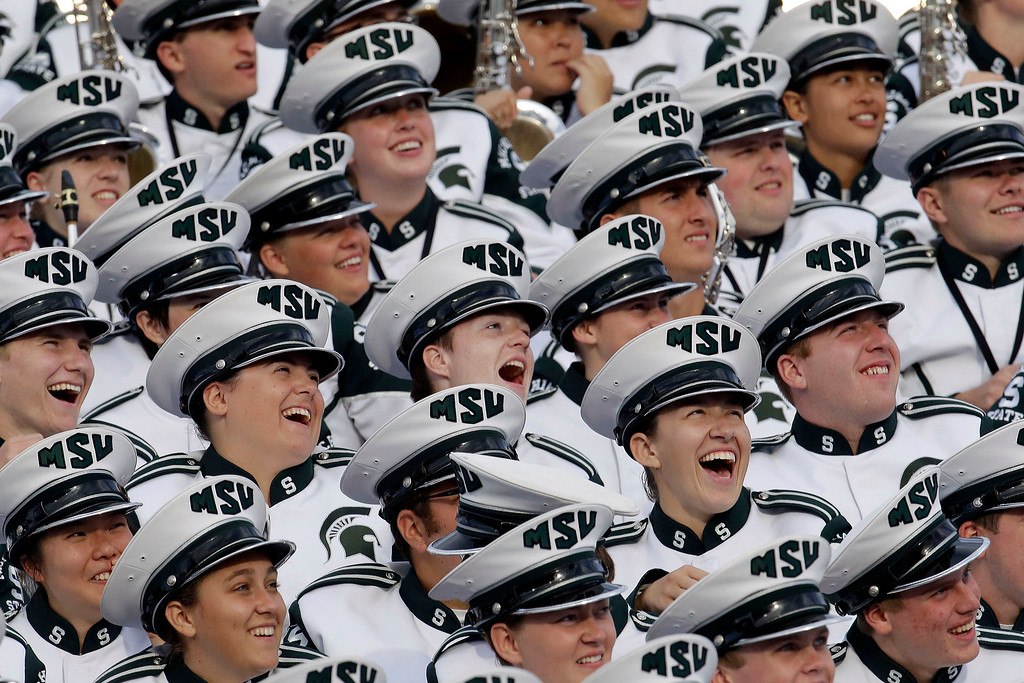 . Members of the Michigan State band laugh during a timeout promotion on the video board during the second half of an NCAA college football game against Purdue in West Lafayette, Ind., Saturday, Oct. 11, 2014. Michigan State won 45-31. (AP Photo/AJ Mast)