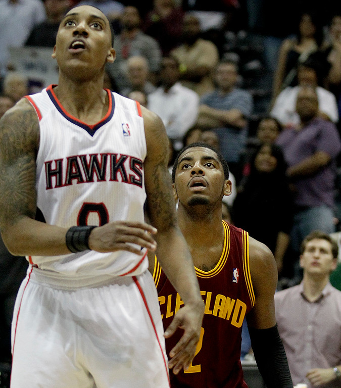 . Cleveland Cavaliers point guard Kyrie Irving, rear, and Atlanta Hawks point guard Jeff Teague play during an NBA basketball game Wednesday, March 21, 2012, in Atlanta. (AP Photo/David Goldman)