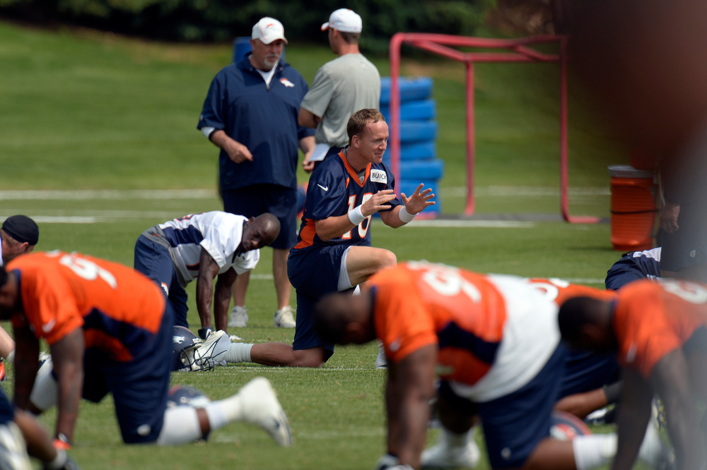 . ENGLEWOOD, CO. - JUNE 13: Peyton Manning (18) QB of the Denver Broncos stretches during the las day of minicamp June 13, 2013 at Dove Valley. (Photo By John Leyba/The Denver Post)