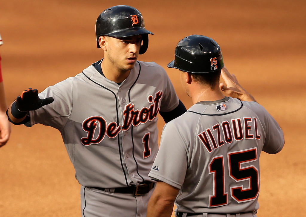 . Detroit Tigers\' Jose Iglesias, left, is congratulated by first base coach Omar Vizquel after hitting an RBI single during the 10th inning of a baseball game against the St. Louis Cardinals Saturday, May 16, 2015, in St. Louis. (AP Photo/Jeff Roberson)