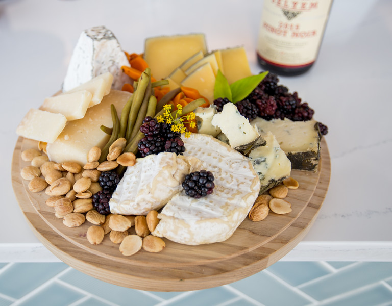 Star Provisions cheesemonger, Meghan Fitzgerald, provides cheese boards.  The collection of cheese, fruit and pickled carrots and green beans is a party tray with a variety of goat and cow options from Thomasville GA to England.   The new Star Provisions location is at 1460 Ellsworth Industrial Blvd.  (Jenni Girtman / Atlanta Event Photography)