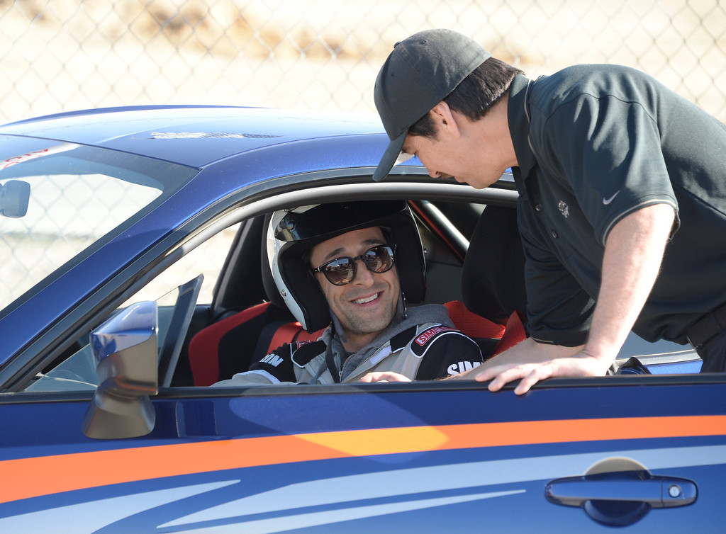 . March 15,2014. Rosamond CA. Academy award winner actor Adrien Brody gets ready to race,  as celebrities in the Long Beach Grand Prix practice racing with instructors in Toyota race cars at the Willow Springs International Raceway. photo  by Gene Blevins/LA DailyNews