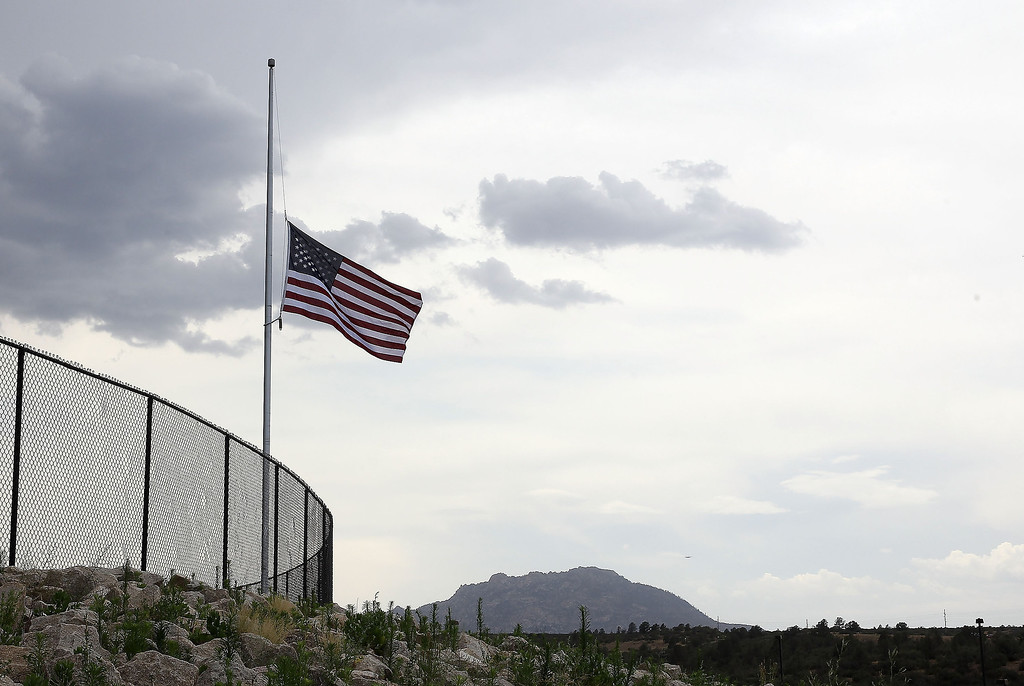 . PRESCOTT, AZ - JULY 01:  An American flag flys at half mast to honor the 19 Granite Mountain Interagency Hotshot Crew firefighters who died Sunday while battling a fast-moving wildfire outside of the memorial service at EmbryRiddle Aeronautical University on July 1, 2013 in Prescott, Arizona.  (Photo by Christian Petersen/Getty Images)
