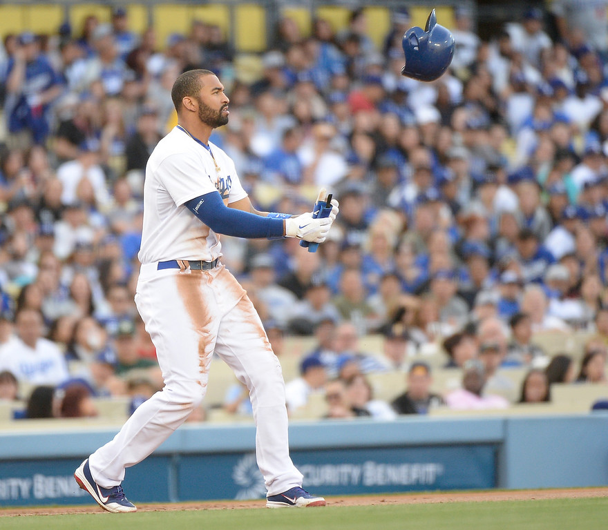 . LOS ANGELES, CA - APRIL 26:  Matt Kemp #27 of the Los Angeles Dodgers retrieves his helmet after stealing third base during the second inning against the Colorado Rockies at Dodger Stadium on April 26, 2014 in Los Angeles, California.  (Photo by Harry How/Getty Images)