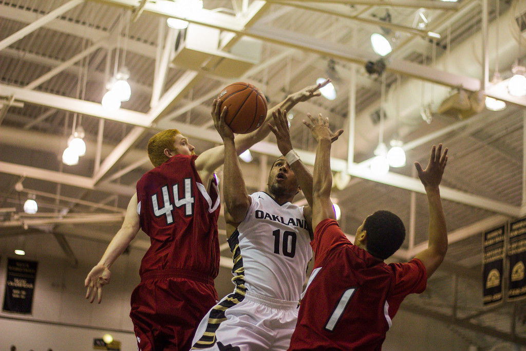 . Mondy pushes past two defenders to make a lay-up. Photo by Dylan Dulberg