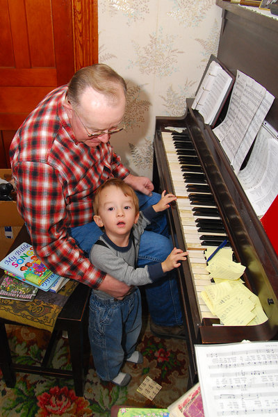 Evan plays the piano with his Grandpa
