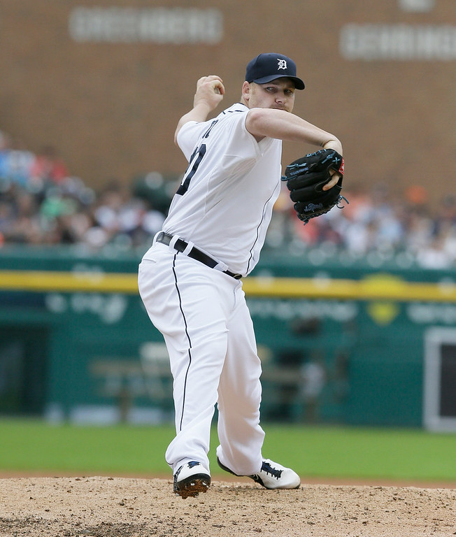 . Detroit Tigers relief pitcher Phil Coke throws during the seventh inning in the first baseball game of a doubleheader against the Cleveland Indians, Saturday, July 19, 2014 in Detroit. (AP Photo/Carlos Osorio)