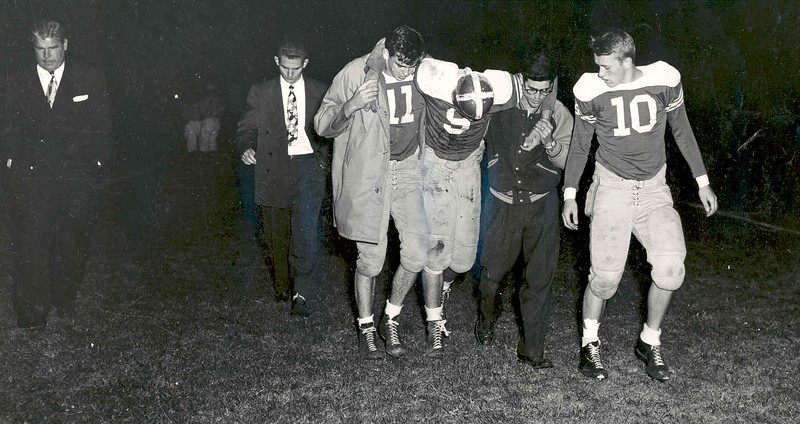 Football 1949 (Ed Panick helps Jim Bucci off the field).jpg