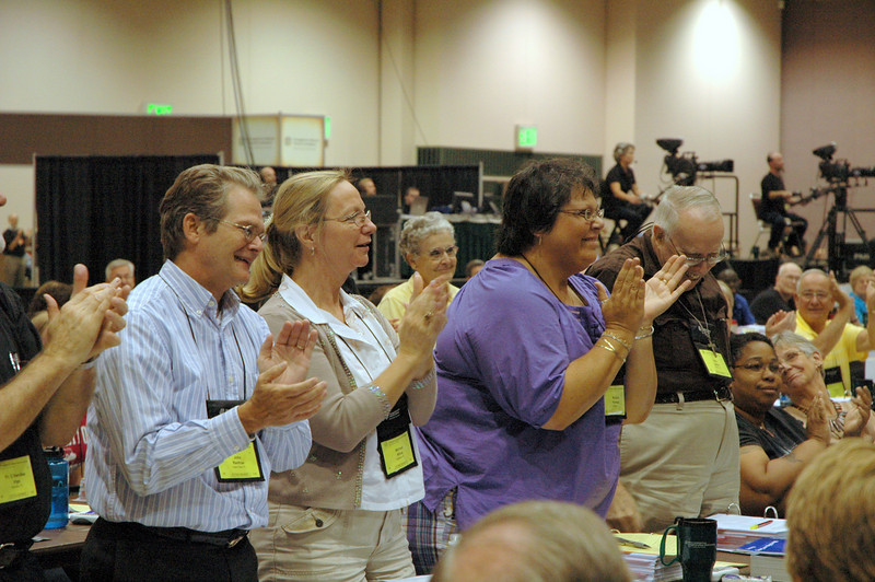 Voting members from the Florida-Bahamas Synod delegation react with excitement as they listen to the announcement that a member of their synod is a winner of ELCA's Video Contest.