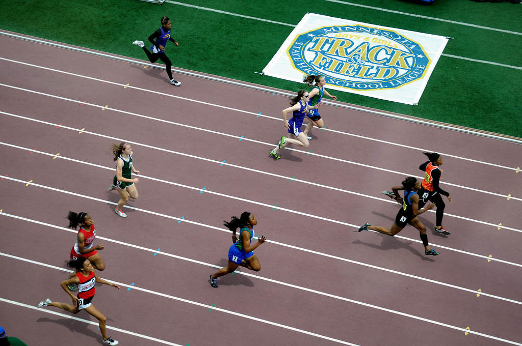 . Runners compete during the Class 2A girls 200-meter dash. Phillis Webb of Osseo placed first with a time of 24.83. (Pioneer Press: Sherri LaRose-Chiglo)