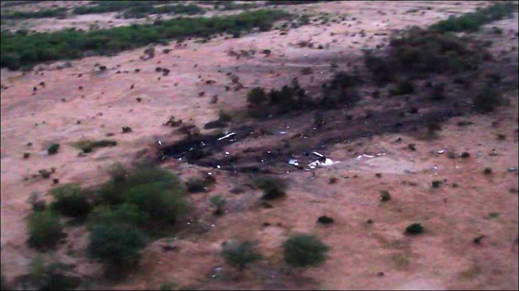 . This photo provided Friday, July 25, 2014 by the French army shows the site of the plane crash in Mali. French soldiers secured a black box from the Air Algerie wreckage site in a desolate region of restive northern Mali on Friday, the French president said.  (AP Photo/ECPAD)