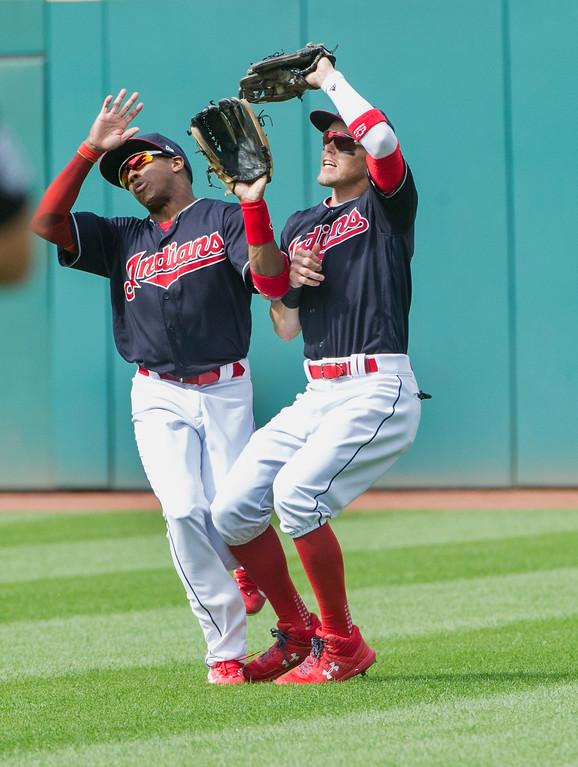 . Cleveland Indians center fielder Greg Allen, left, and right fielder Brandon Guyer collide as Guyer catches a fly ball against the Minnesota Twins during the eighth inning of a baseball game in Cleveland, Thursday, Aug. 30, 2018. (AP Photo/Phil Long)