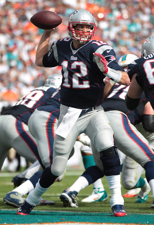 . New England Patriots quarterback Tom Brady (12) looks to pass during the first half of an NFL football game against the Miami Dolphins, Sunday, Dec. 15, 2013, in Miami Gardens, Fla. (AP Photo/J Pat Carter)