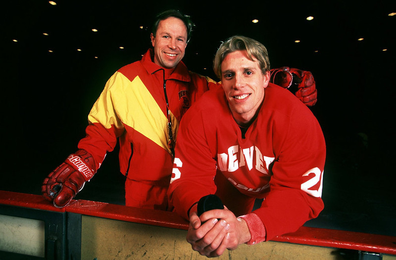 . University of Denver hockey coach George Gwozdecky,  left, and Swedish player Erik Andersson, right.  Karl Gehring/The Denver Post