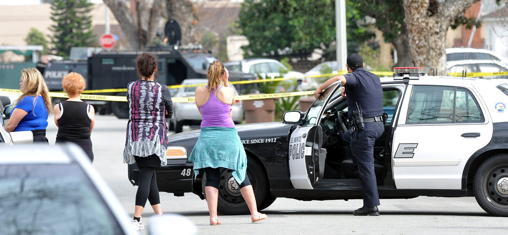 . Neighbor watch El Monte SWAT Team members at the home on the 11400-block of Elmcrest Street in El Monte finding the suspect dead after a standoff on Friday March 7, 2014. The suspect shot his neighbor over a dispute Friday morning. (Photo by Keith Durflinger/San Gabriel Valley Tribune)