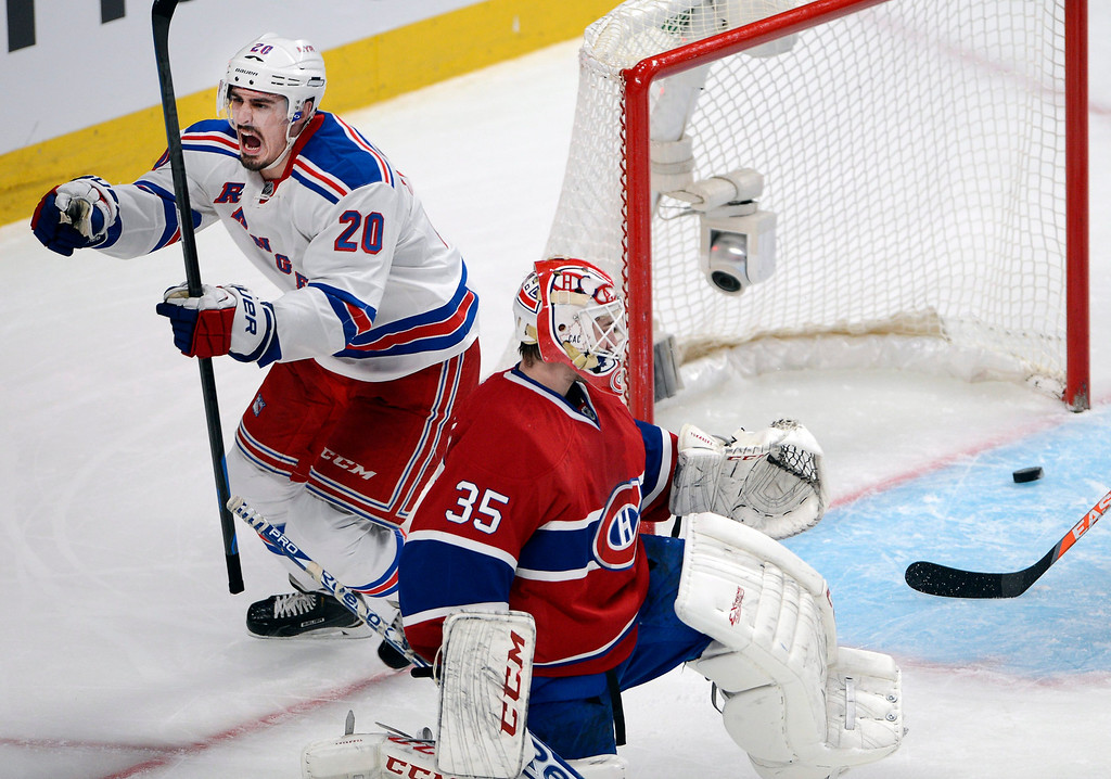 . New York Rangers left wing Chris Kreider (20) celebrates after scoring against Montreal Canadiens goalie Dustin Tokarski (35) during the second period of Game 5 of the NHL hockey Stanley Cup playoffs Eastern Conference finals, Tuesday, May 27, 2014, in Montreal. (AP Photo/The Canadian Press, Ryan Remiorz)