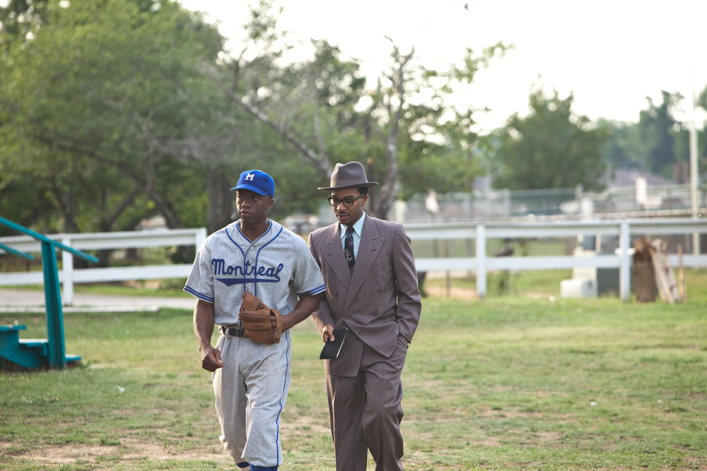 ". (L-r) CHADWICK BOSEMAN as Jackie Robinson and ANDRE HOLLAND as Wendell Smith in Warner Bros. Pictures� and Legendary Pictures� drama �""42\"" a Warner Bros. Pictures release."