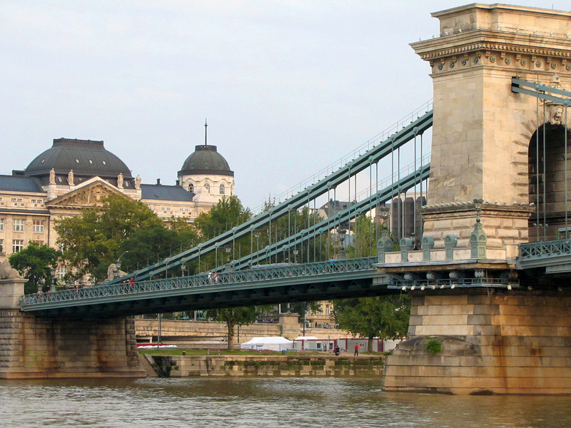 31-Chain Bridge; Gresham Palace. The bridge was severely damaged during Siege of Budapest (WW II). It was rebuilt and reopened 1949.