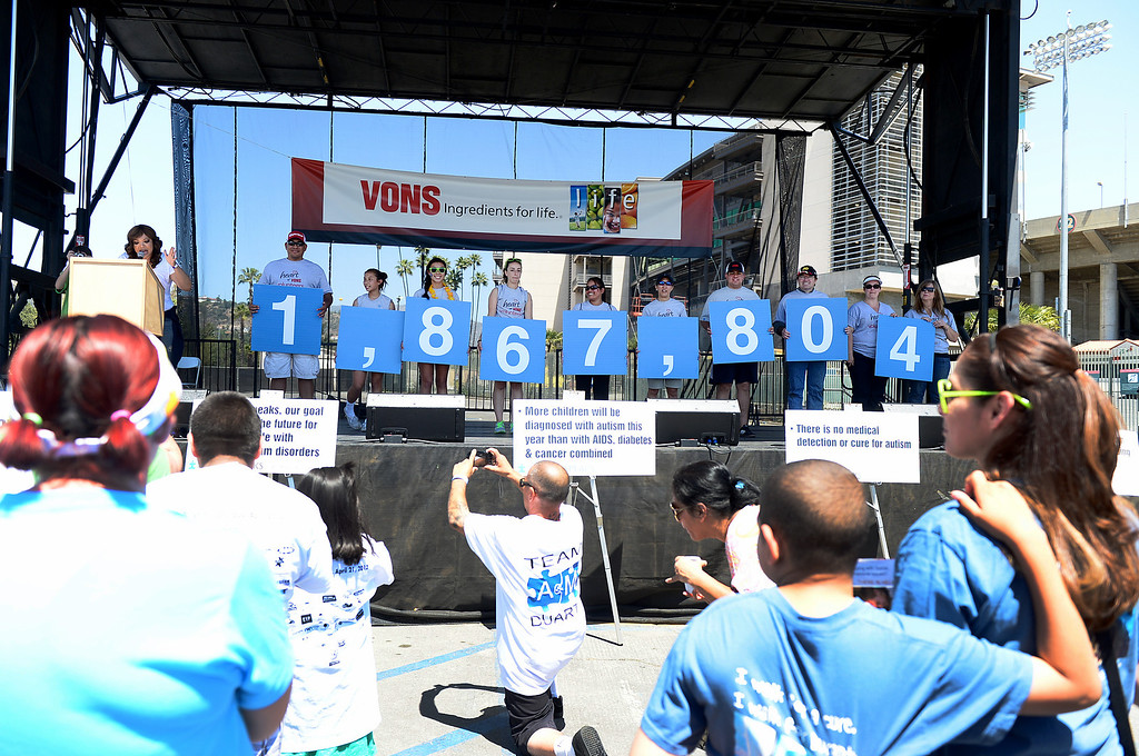 . The amount of money raised during the 11th annual Los Angeles Walk Now for Autism Speaks at the Rose Bowl in Pasadena Saturday April 20, 2013 is shown on the stage. (SGVN/Staff Photo by Sarah Reingewirtz)
