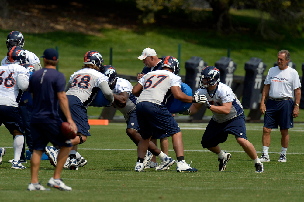 . The Denver Broncos offensive line gets in reps during the last day of  minicamp June 13, 2013 at Dove Valley. (Photo By John Leyba/The Denver Post)