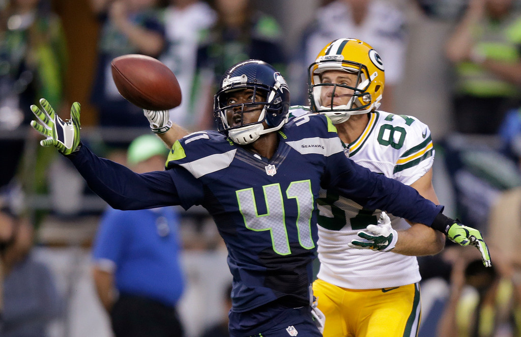 . Seattle Seahawks cornerback Byron Maxwell (41) breaks up a pass intended for Green Bay Packers wide receiver Jordy Nelson (87) during the second half of an NFL football game, Thursday, Sept. 4, 2014, in Seattle. (AP Photo/Stephen Brashear)