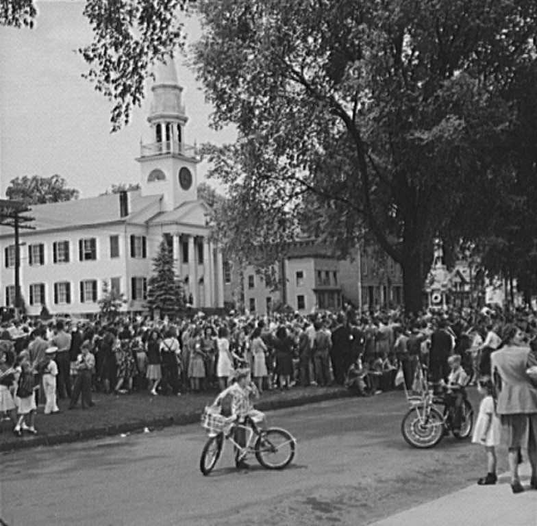 . Southington, Connecticut. An American town and its way of life. The Memorial Day parade moving down the main street. The small number of spectators is accounted for by the fact that the town\'s factories did not close. 1942. Fenno Jacobs, Photographer. Courtesy the Library of Congress