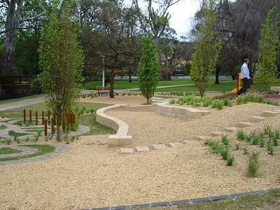 maze with stone path and timber poles