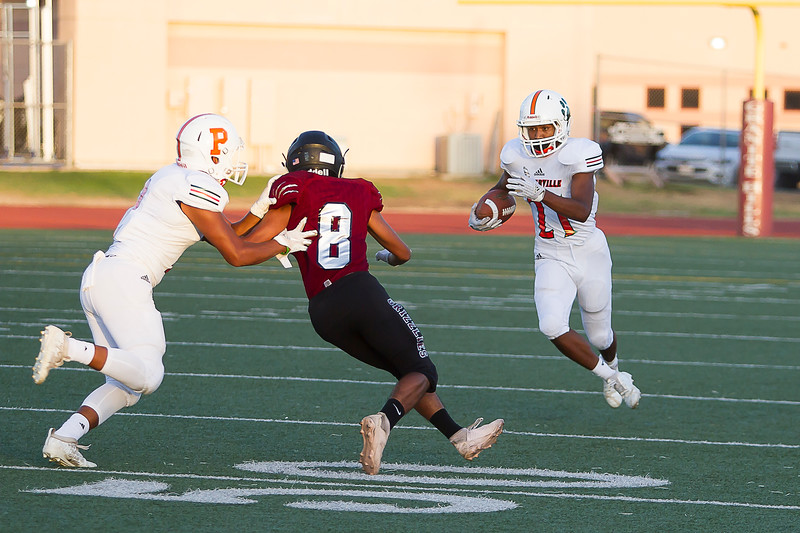 Porterville Panther running back Isiah Ellis (21) carries the ball against the Granite HIlls Grizzlies. Ellis would run for 110 yards on 7 carries and score 2 touchdowns in the Panther's 53-7 win over Granite HIlls.