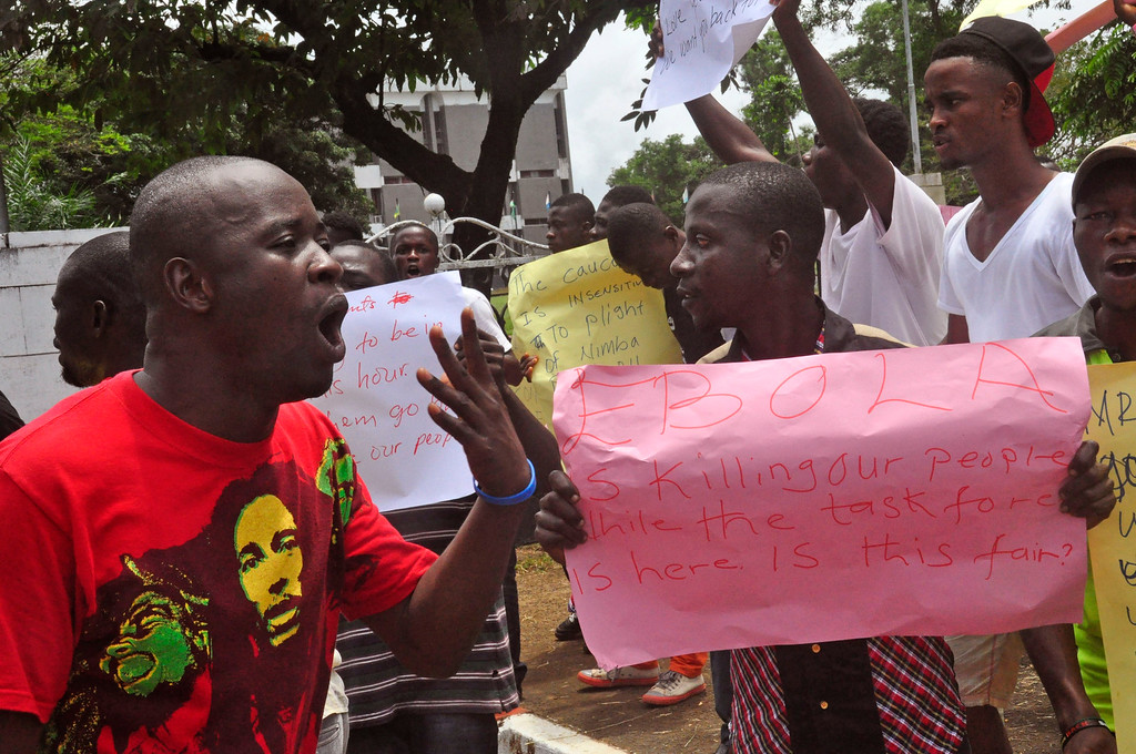. People protest against the governments lack of help to the public with the Ebola virus in their communities, outside the Liberian House of Representative in Monrovia, Liberia, Tuesday, Sept. 23, 2014. U.S. health officials Tuesday presented worst-case and best-case scenarios for the Ebola epidemic in West Africa, calculating that as many as 1.4 million people could be sickened in two countries alone by mid-January _ or the outbreak could be winding down by then, if control efforts substantially increase. (AP Photo/Abbas Dulleh)