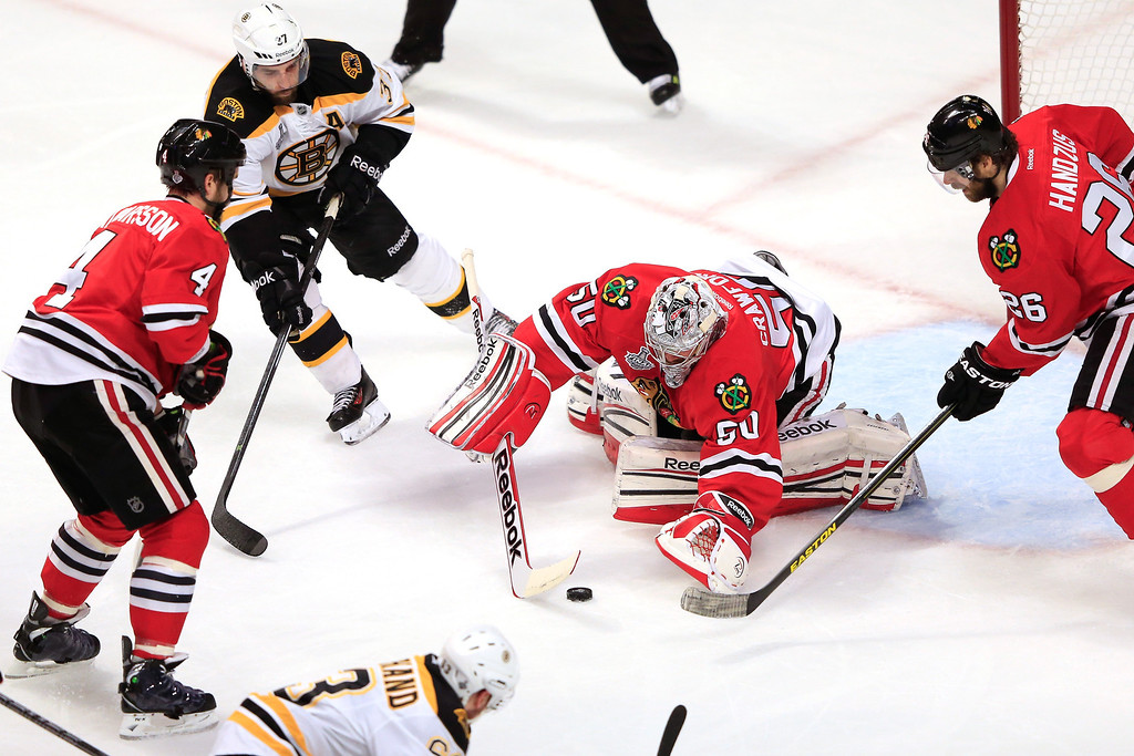 . CHICAGO, IL - JUNE 22:  Corey Crawford #50 of the Chicago Blackhawks makes a save against the Boston Bruins in Game Five of the 2013 NHL Stanley Cup Final at United Center on June 22, 2013 in Chicago, Illinois.  (Photo by Jamie Squire/Getty Images)