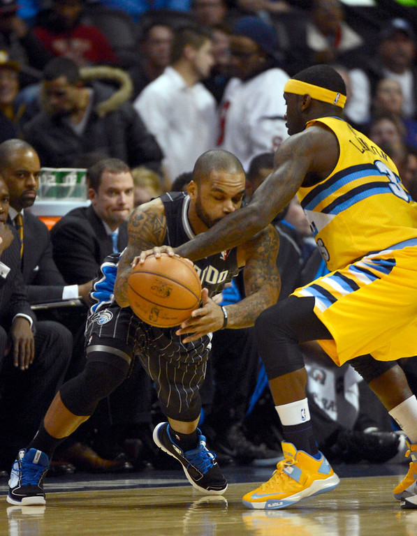 . Orlando Magic point guard Jameer Nelson (14) runs in to the arm o fDenver Nuggets point guard Ty Lawson (3) during the first quarter Wednesday, January 9, 2013 at Pepsi Center. John Leyba, The Denver Post