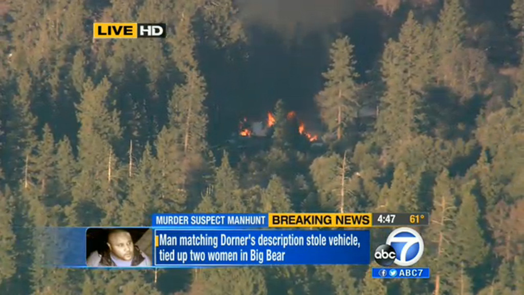 . In this image taken from video provided by KABC-TV, the cabin in Big Bear, Calif. where ex-Los Angeles police officer Christopher Dorner is believed to be barricaded inside is in flames Tuesday, Feb. 12, 2013. (AP Photo/KABC-TV) MANDATORY CREDIT: KABC-TV