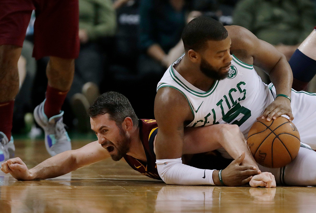 . Cleveland Cavaliers center Kevin Love, left, and Boston Celtics center Greg Monroe scramble for a loose ball during the first half in Game 2 of the NBA basketball Eastern Conference finals Tuesday, May 15, 2018, in Boston. (AP Photo/Charles Krupa)