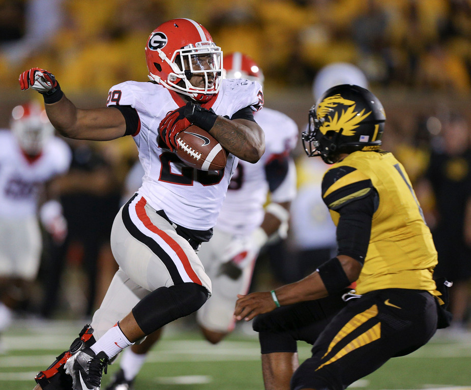 . Jarvis Jones #29 of the Georgia Bulldogs returns an interception past quarterback James Franklin #1 of the Missouri Tigers at Memorial Stadium on September 8, 2012 in Columbia, Missouri. Jones was selected 17th by the Pittsburgh Steelers in the 2013 NFL Draft. (Photo by Ed Zurga/Getty Images)