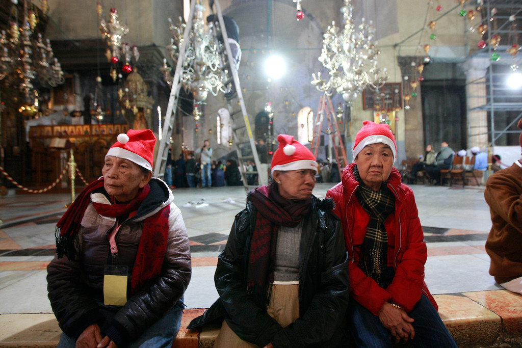 . Christian worshippers visit the Church of Nativity, traditionally believed by Christians to be the birthplace of Jesus Christ, in the West Bank town of Bethlehem on Christmas Eve, Tuesday, Dec. 24, 2013. (AP Photo/Majdi Mohammed)