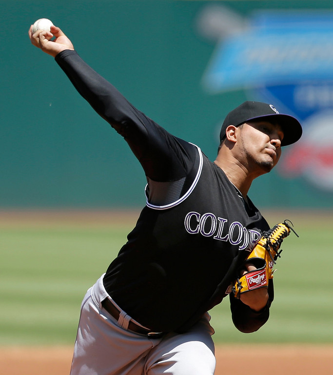 . Colorado Rockies starting pitcher Jhoulys Chacin delivers in the first inning of a baseball game against the Cleveland Indians, Sunday, June 1, 2014, in Cleveland. (AP Photo/Tony Dejak)
