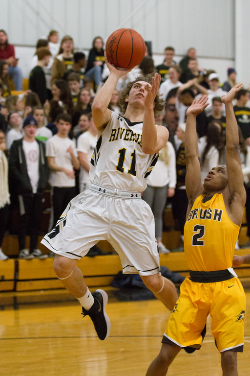 . Barry Booher - The News-Herald Action from Brush-Riverside boys basketball Dec. 15.